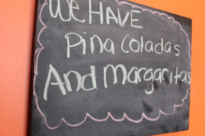 las-enchiladas sign on the wall